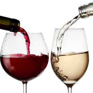 Red and white wine pouring in two glasses